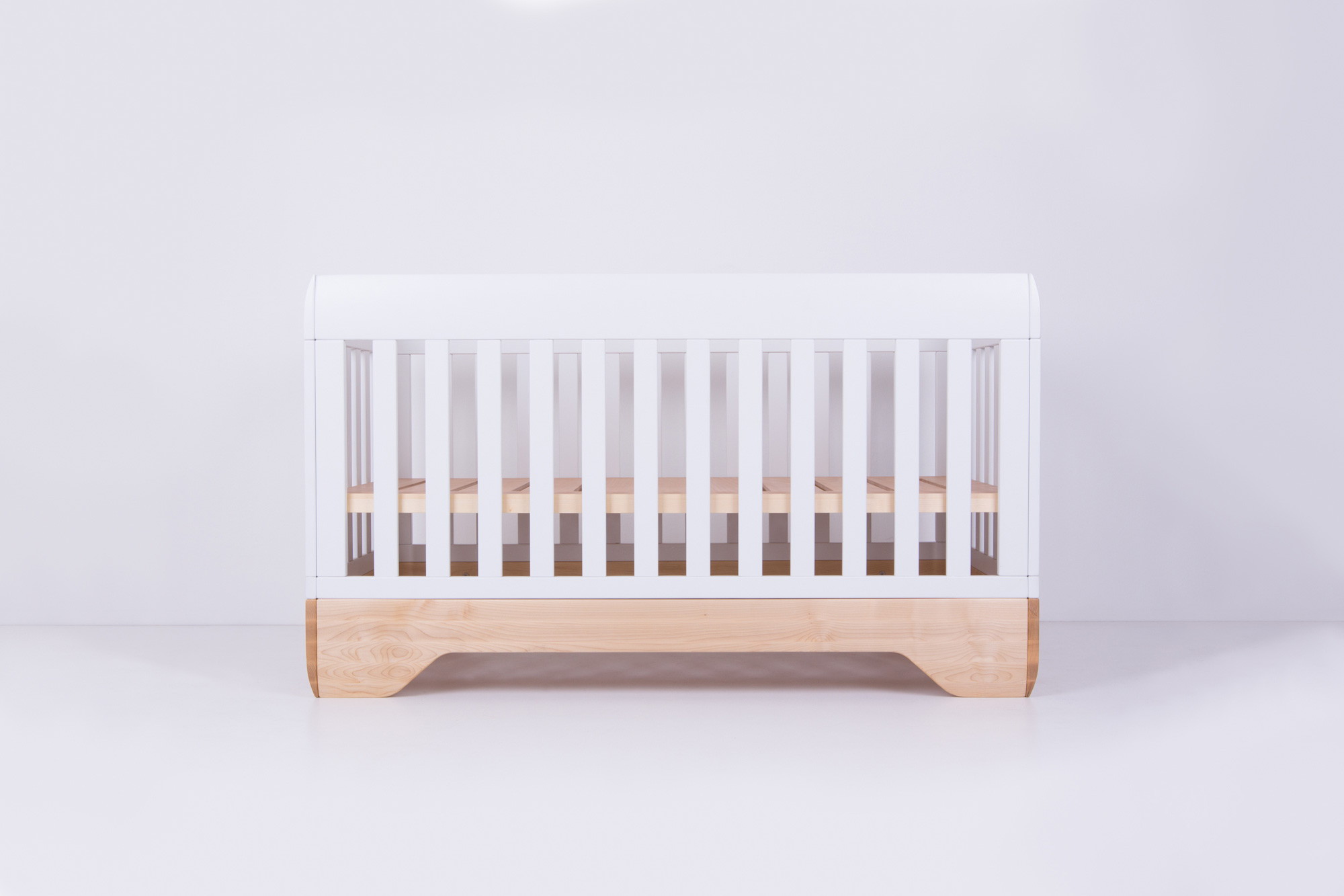 Echo Crib with mattress support in high position