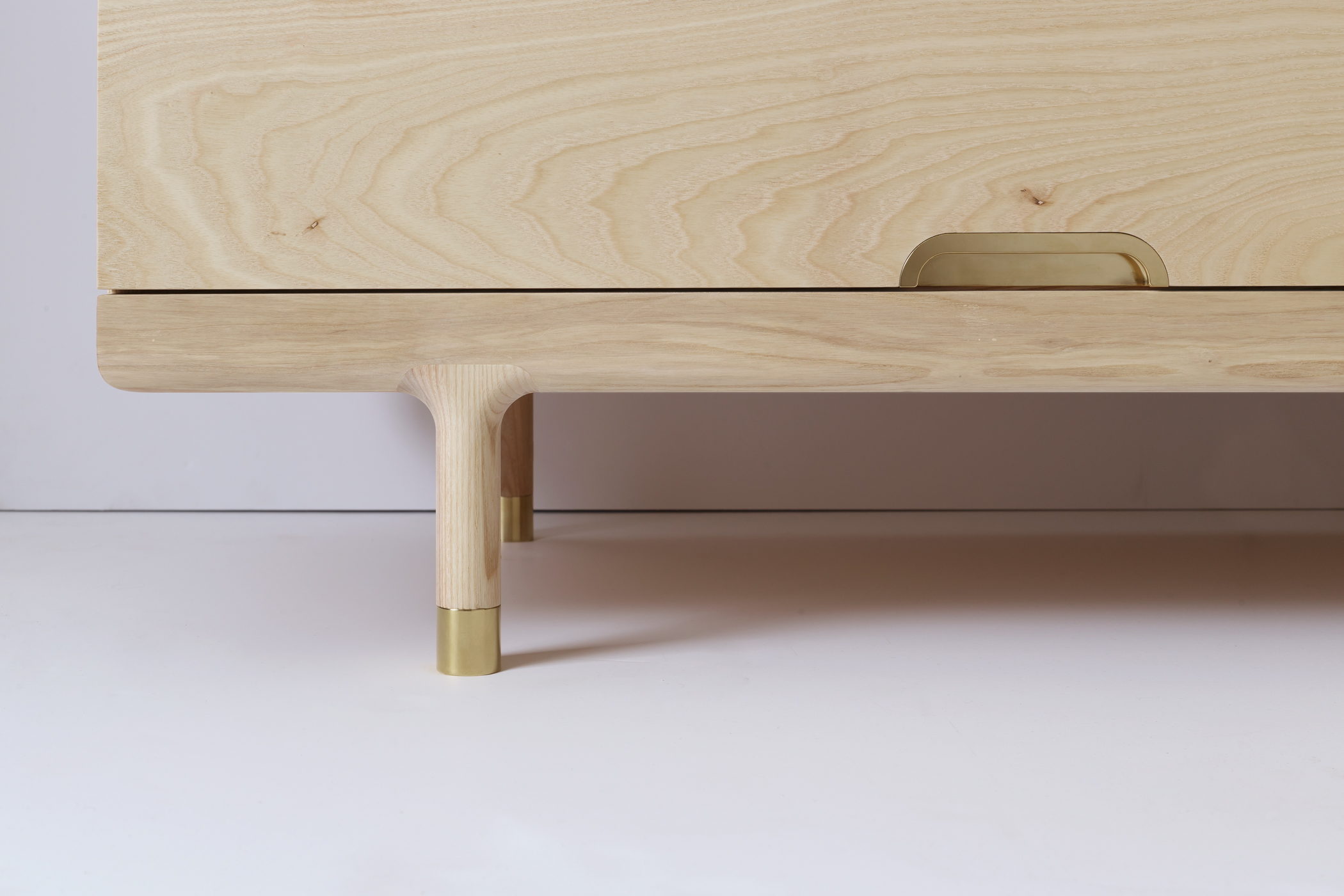 Simple Dresser Brass Foot and Drawer Pull Detail