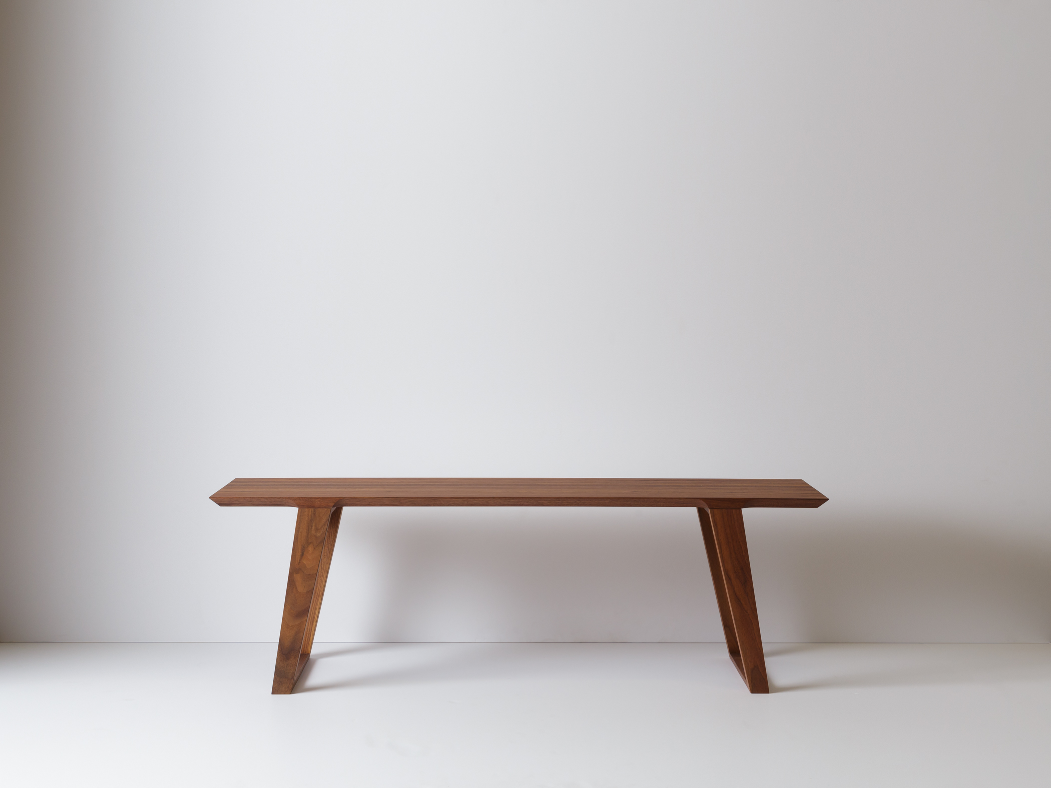 Modern Contemporary Isometric Bench Coffee Table in solid walnut