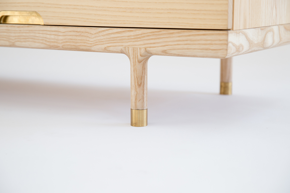 Simple Dresser detail of foot solid ash and brass